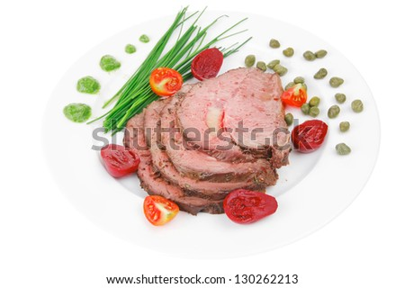 grilled barbecue on white dish with capers - stock photo