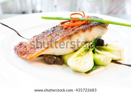 grilled barramundi steak with sweet sauce - stock photo