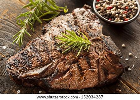 Grilled BBQ T-Bone Steak with Fresh Rosemary - stock photo