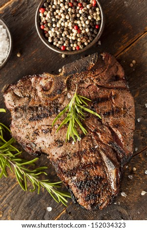 Grilled BBQ T-Bone Steak with Fresh Rosemary - stock photo