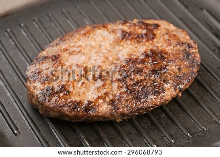 Grilled beef burger with cherry tomatoes - stock photo