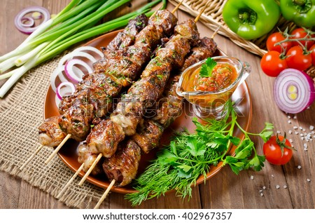 Grilled beef liver kebabs wrapped the fatty in a grid - stock photo