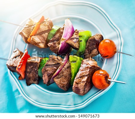 grilled beef shishkabobs viewed from high angle - stock photo