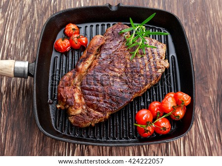 Grilled Beef Sirloin Steak on iron pan with vegetables. - stock photo