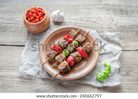 Grilled beef skewers with pepper and brussels - stock photo