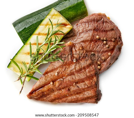 grilled beef steak and zucchini on white background - stock photo