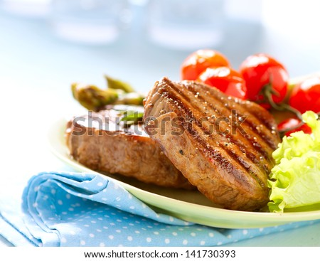 Grilled Beef Steak Meat with Asparagus and Cherry Tomato. Steak Dinner. Food. BBQ Grill. Berbeque - stock photo