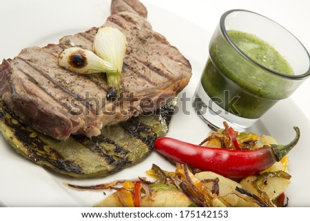 Grilled beef steak served on cactus with vegetables and salsa dip chili decoration Close up - stock photo
