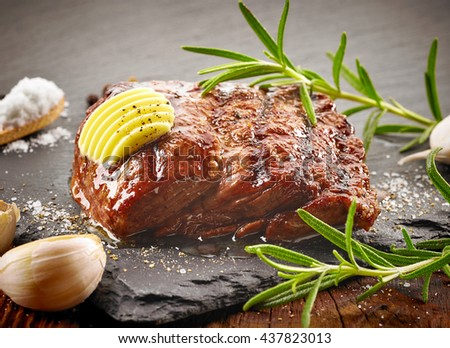 grilled beef steak with butter and spices - stock photo