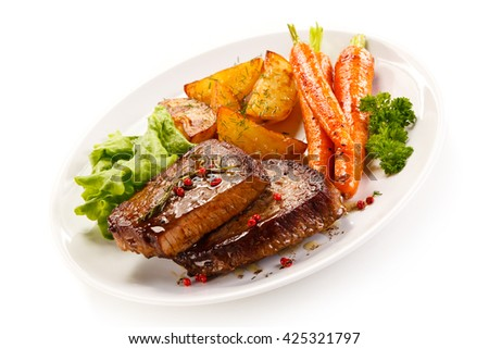 Grilled beef steaks and vegetables  - stock photo