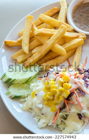 Grilled beefsteak French fries and  salad vegetables - stock photo