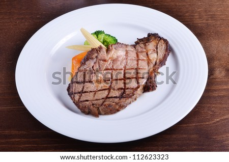 Grilled beefsteak  on a plate - stock photo
