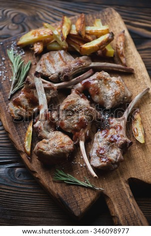 Grilled bobby veal rack steaks with fries, selective focus - stock photo