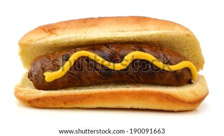 Grilled Bratwurst with mustard on bun. Isolated.  - stock photo