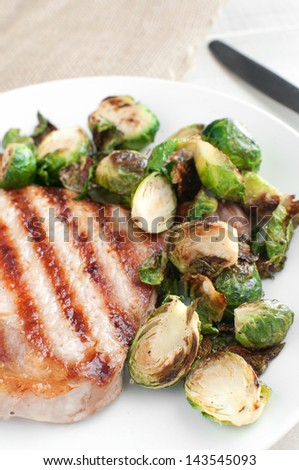 Grilled brussels sprouts and pork meat close up - stock photo