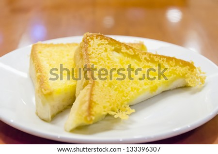 Grilled Butter Bread Served On A Plate - stock photo