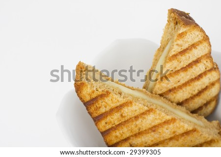 Grilled cheese sandwich in white bowl. Wholewheat bread. - stock photo
