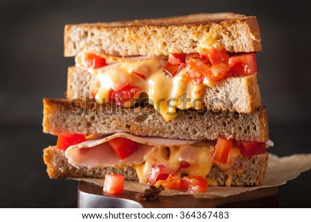 grilled cheese sandwich with ham and tomato - stock photo