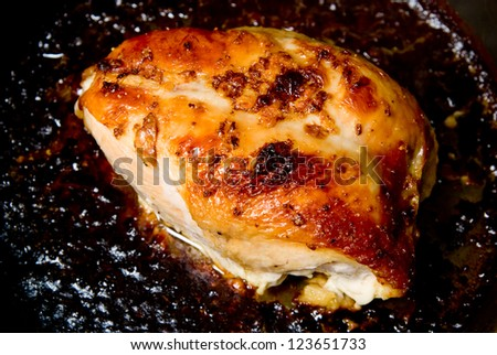 Grilled chicken breast in a pan - stock photo