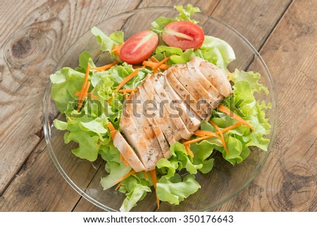 Grilled chicken breast salad. Top view. - stock photo