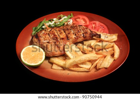 grilled chicken breast served on a plate - stock photo