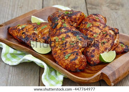 Grilled chicken breast served with herbs and lime - stock photo
