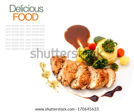 Grilled chicken breast with salad. - stock photo