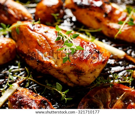 Grilled chicken breast with thyme, lemon and with addition of vegetables - stock photo