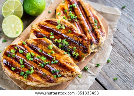 Grilled chicken breasts in lime sauce - stock photo