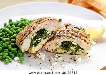Grilled chicken breasts stuffed with spinach and feta cheese.  Delicious! - stock photo