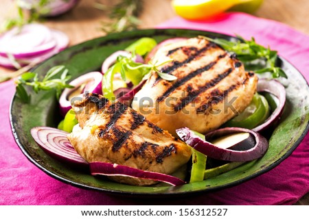 Grilled chicken breasts with onion - stock photo