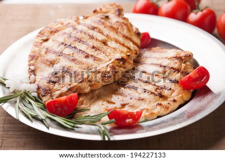 Grilled chicken breasts with rosemary - stock photo