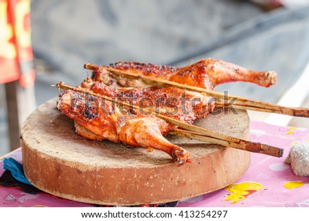 Grilled chicken. chicken on the cutting board. - stock photo