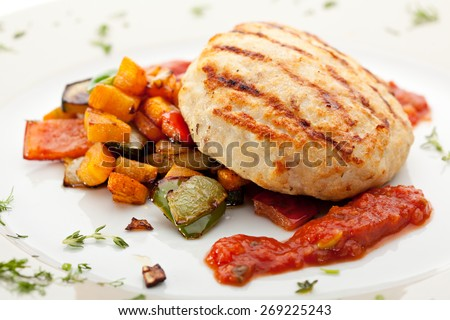 Grilled Chicken Cutlet with BBQ Vegetables and Spicy Sauce - stock photo