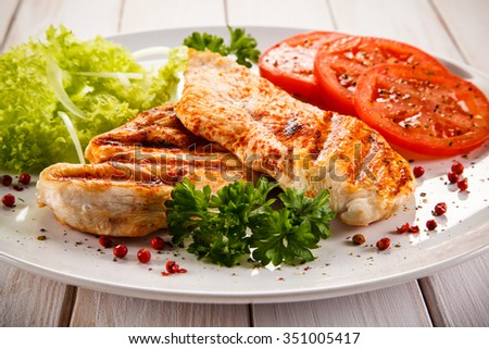 Grilled chicken fillet and vegetables  - stock photo