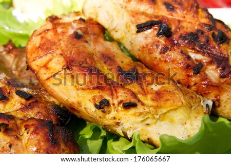 Grilled chicken fillet on salad. - stock photo