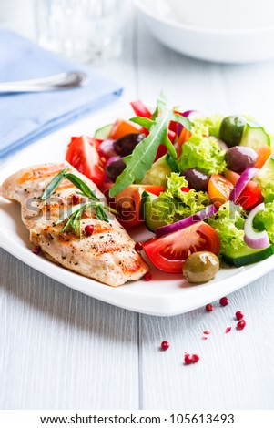 Grilled chicken fillet with fresh vegetables - stock photo