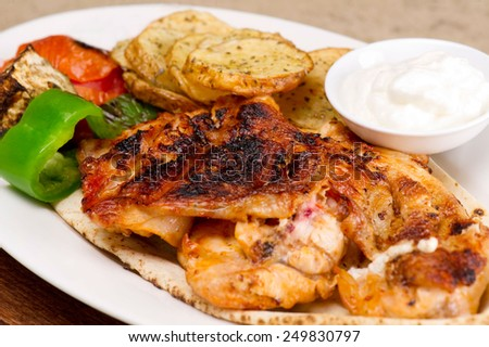 Grilled chicken fillets, with potatoes and vegetables and mayo garlic dip - stock photo