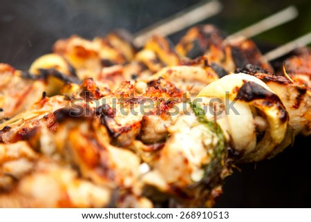 Grilled chicken Leg on the grill - stock photo
