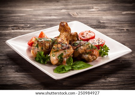 Grilled chicken legs and vegetables  - stock photo