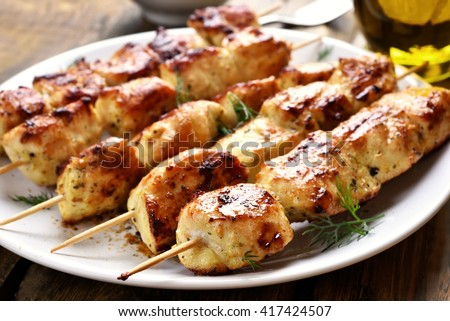 Grilled chicken on bamboo skewers, close up view - stock photo