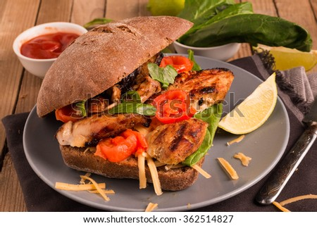 Grilled Chicken Sandwich with tomatoes and spinach. Selective Focus.  - stock photo
