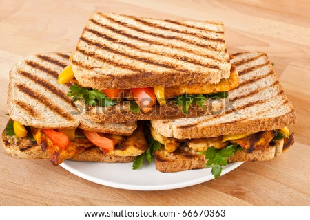 grilled chicken sandwiches on a plate - stock photo