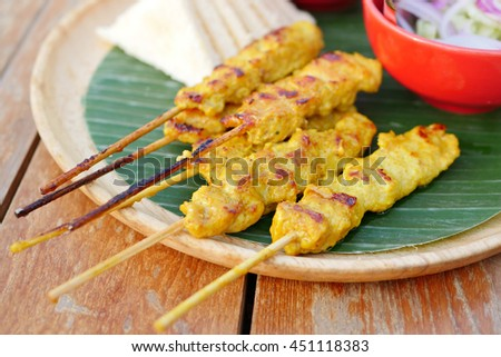 grilled chicken satay with dipping sauce and side dish - stock photo