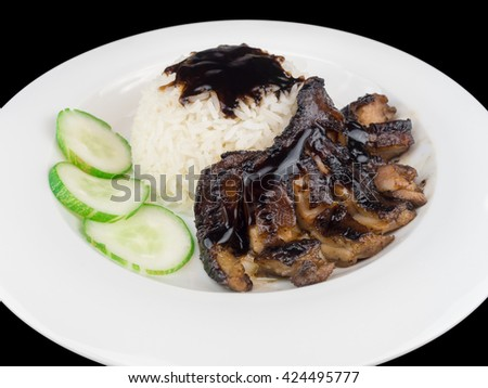 Grilled chicken teriyaki with rice and vegetables on a white plate isolated on the black background with clipping path - stock photo