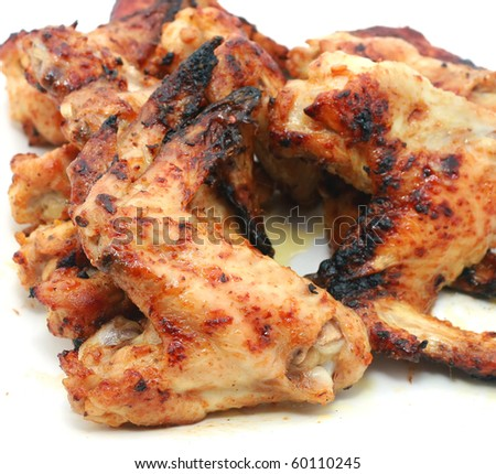 Grilled chicken wings on a white background - stock photo