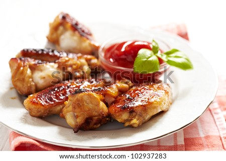 Grilled Chicken Wings with Sauce - stock photo