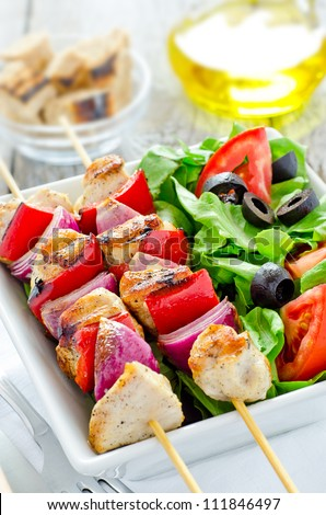 Grilled chicken with peppers and tomato salad - stock photo