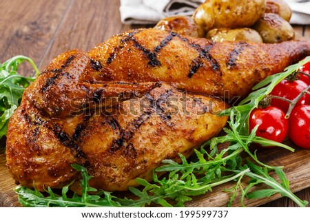 grilled chicken with potatoes half  - stock photo