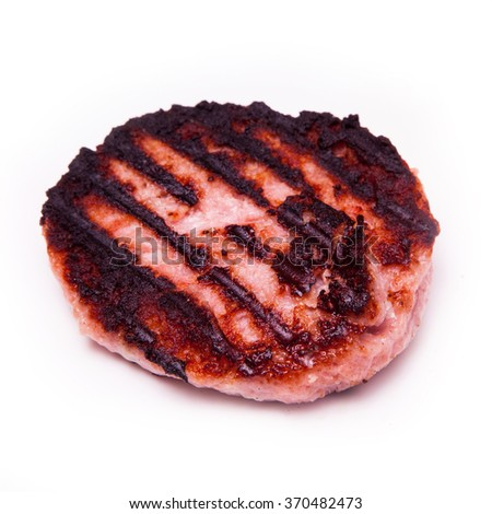 Grilled crocodile meat burgers isolated on a white studio background. - stock photo